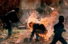 """Kevin Carter was the first photographer to take images of the """"necklacing"""" in South Africa in the mid Kevin Carter, New York Times, Freedom Party, Fotojournalismus, African National Congress, Jamel, Human Torch, Iconic Photos, Amazing Photos"""