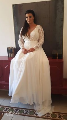 Plus size boho wedding gown with sleeves and chiffon skirt with long train. ff36d68cffb0