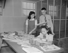 Postmaster Fred R. Paris with mail clerks, Jerome War Relocation Center, Arkansas, 20 Nov 1942 (US National Archives)