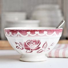 A vintage French cafe au lait bowl with a red rose by Digoin