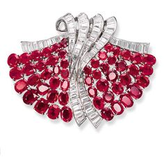 "A CHIC ART DECO RUBY AND DIAMOND ""ÉVENTAIL"" DOUBLE-CLIP BROOCH, BY VAN CLEEF & ARPELS Designed as twin oval-cut ruby fans to the baguette-cut diamond scrolled handle, 1937, with French assay marks, in a Van Cleef & Arpels grey suede case Signed Van Cleef & Arpels, Paris, no. 47732"