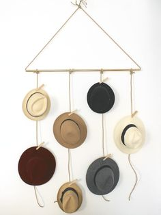 Decorating doesn't always mean going out to buy something new to make your home look beautiful. It's about arranging what you already have. Try pulling together something you have in numbers (like these hats from Simple & Chic) in a chic yet simple collection. With a quick run to the store or using supplies you already own, a simple DIY project like this is sure to help declutter and freshen up your space.