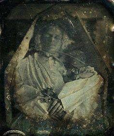 Memento Mori adult female with stillbirth. COD: complications of childbirth.