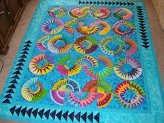 New York Beauty - oh I LOOOOOVE this in turquoise!!  Oh be still my heart!!!!! pieced by Iluv2quilt