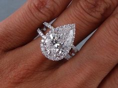 Pear with halo and double band.  This is Beautiful maybe not so big b/c i like having my finger, but I love this!