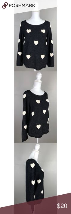 """NWOT Lauren Conrad Fuzzy Hearts Shimmery Sweater NEW without tags!  LC Lauren Conrad. Medium. Black & white with metallic thread. Long sleeves, shimmery black sweater with fuzzy white hearts on the front and on the sleeves.Picturesare a part of the description.  90% Acrylic, 6% Polyester, 4% Other- Hand wash  {Measurements taken flat without stretching} Armpit to armpit approximately 19"""" Length approximately 25""""  FAST SHIPPING!Usually ships same or next business day!! {Seller's note:E1}…"""