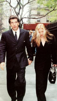 May 19, 1996 – JFK, Jr and his fiancee Carolyn Bessette at a Memorial for his mother Jackie Kennedy Onassis.