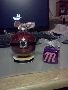 Two glitter ornaments I made.