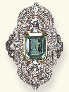 A belle époque emerald and diamond ring. Set with a rectangular-cut emerald, flanked on each side by old European or marquise-cut diamonds, within an old European-cut diamond two-tiered surround, to the openwork gallery and old European-cut diamond shoulders, mounted in platinum and gold, circa 1900. Deco Engagement Ring, Antique Engagement Rings, Antique Rings, Antique Jewelry, Vintage Jewelry, Art Deco Ring, Art Deco Jewelry, Fine Jewelry, Emerald Jewelry