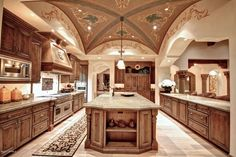Mediterranean Kitchen with Decolav granite countertop in carmello, double oven range, Raised panel, Box ceiling, can lights