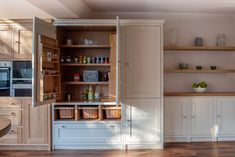 A pantry cupboard with spice racks, handwoven vegetable baskets and an integrated fridge freezer. Perfect kitchen organisation by keeping all the food in one zone. Kitchen Cabinet Makers, Kitchen Pantry Design, Kitchen Organisation, Kitchen Storage, Larder Cupboard, Pantry Cabinets, Cookbook Storage, Pot Storage, Timber Kitchen