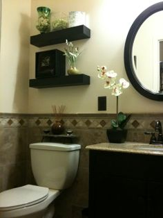 maybe not that tile, but I love I like the black wood and accents- guest bathroom