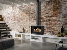 Discover recipes, home ideas, style inspiration and other ideas to try. Wood Burner Fireplace, Fireplace Tv Wall, Modern Fireplace, Living Room With Fireplace, Fireplace Design, Exposed Brick Fireplaces, Modern Wood Burning Stoves, Room Deco, Freestanding Fireplace