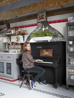 A piano -- in the kitchen! Perfect for musician Neko Case. This would be perfect for me too! Love this idea.