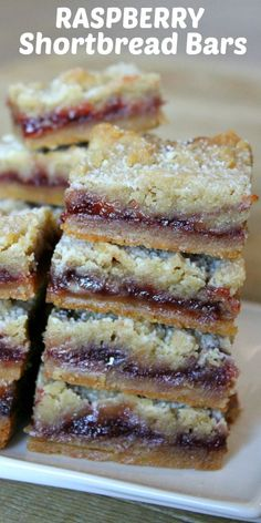 Easy and delicious Raspberry Shortbread Bars. These bars have a buttery shortbread crust and are baked with raspberry jam and more shortbread crumbs on top. Raspberry Cookies, Raspberry Desserts, Just Desserts, Delicious Desserts, Yummy Food, Rasberry Bars, Raspberry Oatmeal Bars, Blueberry Recipes, Sweet Desserts