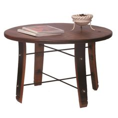 "Round Stave Coffee Table - Our American made Round Stave Coffee Table is made from recycled oak wine barrels. Features wine stave legs with wrought iron cross braces. Pair it with our Round Stave End Table to complete your wine inspired decor. Environmentally conscious, this line uses recycled, antique lumber and recycled wine barrels whenever possible. The designs will make a statement in any room of your home.  Dimensions: 20"" high x 32"" diameter; Weight is 30 lbs."