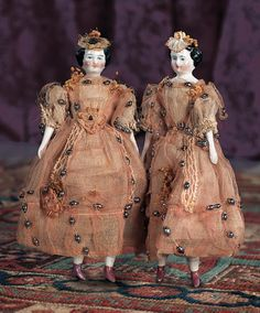 """German Porcelain Dollhouse Dolls in Original Costumes - 7"""" (18 cm.) Each has porcelain shoulder head with black sculpted short curly hair,painted facial features,blue eyes,closed mouth,muslin body,porcelain limbs,painted pink luster shoes. Condition: generally excellent. Comments: Germany,circa 1875."""