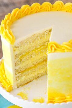 This easy lemon cake recipe makes a moist cake with alternating layers of lemon bavarian cream, and lemon curd filling with lemon buttercream! Yum!