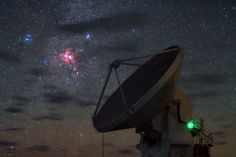 """cosmicvastness: """"Starbirth over ALMAIn this wonderful high definition, singe-exposure image taken during the ESO Ultra HD Expedition, three deep sky objects seem to shine in front of the dish of one..."""