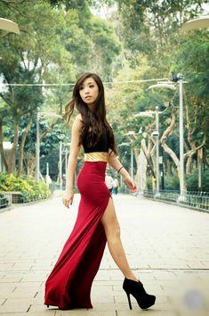 Black sleeveless blouse with maroon stylish long maxi dress and stylish black high heels boots. Follow us on IG @lebellesblock