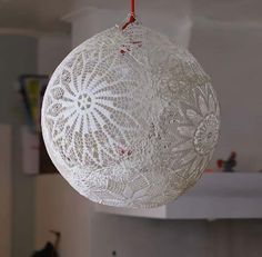Blow up a balloon....cover with lace soaked in fabric starch or plaster.... Let dry. Pop balloon for the globe of a lamp. Makes an interesting shadow.