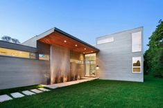 Blaze Makoid design C-shaped house surrounding a courtyard and pool overlooking a field