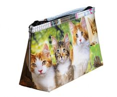 This makeup case is using a collage of cat and kitten images that we cut out of pet lover magazine.  Using YKK zipper Polyester fabric used for the lining.  It is available in two different sizes:  Small case $16: Dimensions in inches: 5 long, 3.3 tall, 2 Thick at the bottom