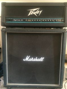 My personal Rig. Marshall half stack with peavy supreme 160 head. I've had  this amp for years it's still at my moms house for years with my guitar . Surprisingly this old head has a great hard-core thrash punk rock sound it's done we wEll. Funny story how I got a hold of the head. Eventually I would like to update all my equipment. Still this is an awesome head. Hopefully soon I'll post some videos of me playing guitar. If you like hard-core punk rock.