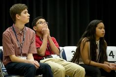Naples Middle School's Ryan Rayos, center, anxiously listens to a competitor spell a word that could win Rayos the 35th annual European PTA Spelling Bee at Ramstein Air Base, Germany, on Saturday, March 18, 2017. Rayos went on to win in the 19th round. (MICHAEL B. KELLER/STARS AND STRIPES)