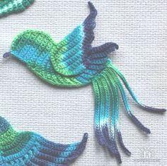 Amazing crochet birds, so artfully combined in a sweater.
