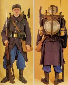 French Soldier's Kit: September-December 1914.This uniform is just one example of the exigent measures taken to reduce the visibility of the uniform in the fall of 1914. The soldier wears a m. 1914 Type 3 greatcoat made from the final existing stocks of a prewar cloth that was dark bluish-gray (not common), m. 1884 kepi in the same, blue canvas trousers (overalls), m. 1913 gaiters, m. 1912 boots, m. 1873 belt, and m. 1888 or 1905 cartridge pouches.