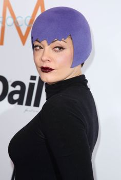 OVER THE TOP HATS and Celebrities Who Wear Them Ѯ Sure, Rose McGowan has some funky style, but this purple helmet left us completely perplexed. Was she going for a superhero-inspired red carpet look at the 2015 Daily Front Row Fashion Awards? © Matt Baron/BEImages/Rex USA