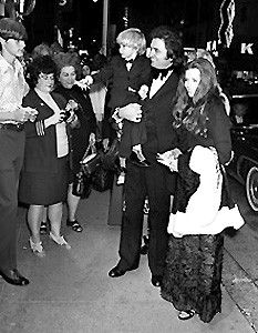 "Johnny Cash, holding his young son, John Carter Cash, arrives with his wife, June Carter Cash at the premiere showing of his movie, ""Gospel .Road' at the Tennessee Theater downtown Nasahville on Church --10--23--1972.."