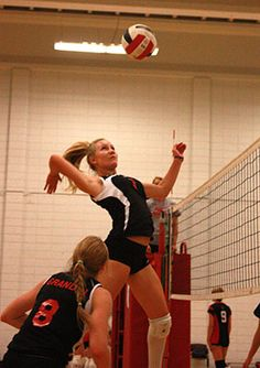 Bishop Grandin's Jenny Rowell in mid-air for a big hit in game action on Sept. 14.    Photo by: Lucas Silva