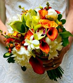 White peonies, White orchids, Orange callas and Green callas with Green orchids.