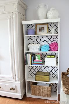 bookcase transformation: use cardboard and fabric instead of paint/wallpaper to easily change the look of your bookcase anytime! Great idea to personalize your room at school!