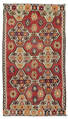 Vintage Turkish tribal kilim rug handwoven in 1960's in the Mut region of the Taurus Mountains by the Taurus Yoruks who are migratory people of Central Asian origin. The weavings of these Yoruks are strong in design and substance, as befits the lifestyle of their makers. Tight slitweave is used, so that the designs do not contain any long vertical slits; this, together with the thick warps and wefts, results in a substantial and hardwearing textile.