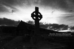 A Gothic image of a Celtic Cross set against a sunset sky