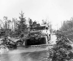 Hurtgen gallery 12 The Hürtgen Forest was secured in early 1945, but that didn't make it an easy place to navigate. This half-track of the 16th Infantry Regiment, 1st Infantry Division, braves a flooded road in the battle-ravaged forest.