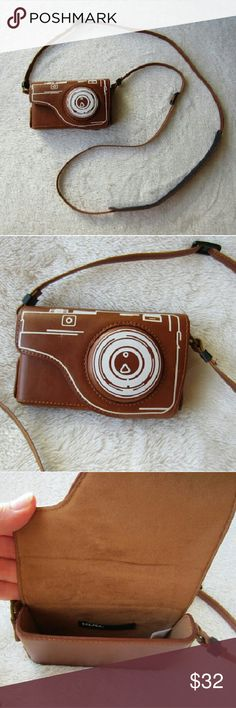 """LAST CALL Urban O. Leather Camera/Phone Case This super fun and handy retro looking camera/phone case is a summer must have item! This piece can carry your smart phone or digital camera. This piece is in beautiful condition, it has no blemishes aside from some leather marks that give the piece a vintage look. 3"""" x 5"""".  Adjustable strap measures 55"""". BDG by Urban Outfitters.   Bundle and save! New Price FIRM unless bundled! Happy Poshing! Urban Outfitters Accessories Phone Cases"""