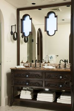 love the faucets and vanity. functional bottom drawers and towel storage underneath.