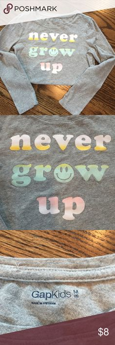 Gap Kids graphic tee You never want them to grow up, but it sure is fun to watch them as they do!  This super cute graphic tee from Gap Kids is in good used condition with sweet saying in glittered pastel lettering.  The size is 8, but this tee ran small in my opinion. GAP Shirts & Tops Tees - Long Sleeve