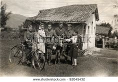 a few soldiers with two girls on the farmhouse - photo scan - about 1945