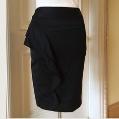 Brand new L.A.M.B wool skirt with ruffle detail! Elegant 100% wool skirt fully lined. Ruffle detail on the side with slit. Never been worn! With tags! This beautiful skirt can be worn in the office or for a night out. L.A.M.B. Skirts