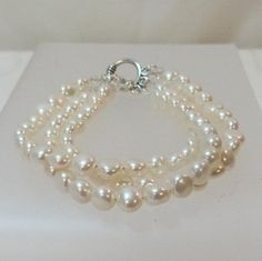 Freshwater Small Puffed Coin Pearl Triple Strand Bracelet by tbyrddesigns on Etsy
