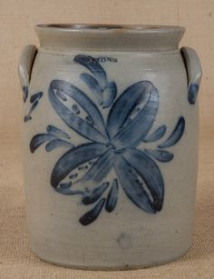New York stoneware crock, 19th c., impressed Lyons, with cobalt floral decoration, 9'' h.