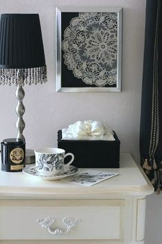Love the framed doily. Perfect addition to the gallery wall with a pop of cold behind it.