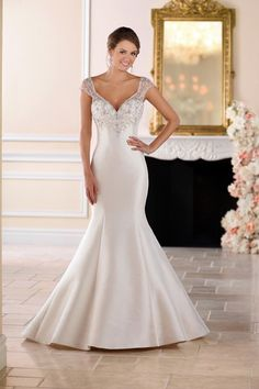 Elegant wedding dress idea - fit-and-flare wedding dress with cap sleeve and beaded illusion back. Style 6451 by @stellayorkbride.