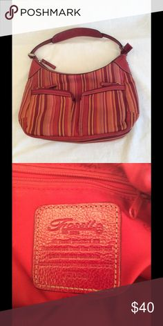 Fossil Purse Authentic striped fossil purse has 2 small front zipper closed pockets, main zip closure and has 1 inside zipper pocket and 2 open pocket. In excellent condition, comes from a smoke free home. #fossil #striped Fossil Bags Shoulder Bags