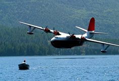A Martin Mars about to pick up water for fighting forest fires.  Might get a small boat, too!